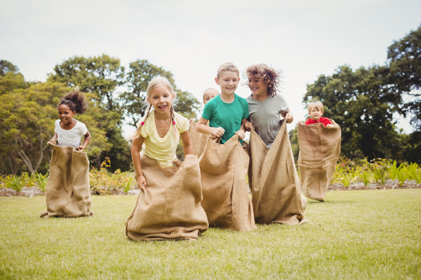 Children,Having,A,Sack,Race,In,Park,On,A,Sunny